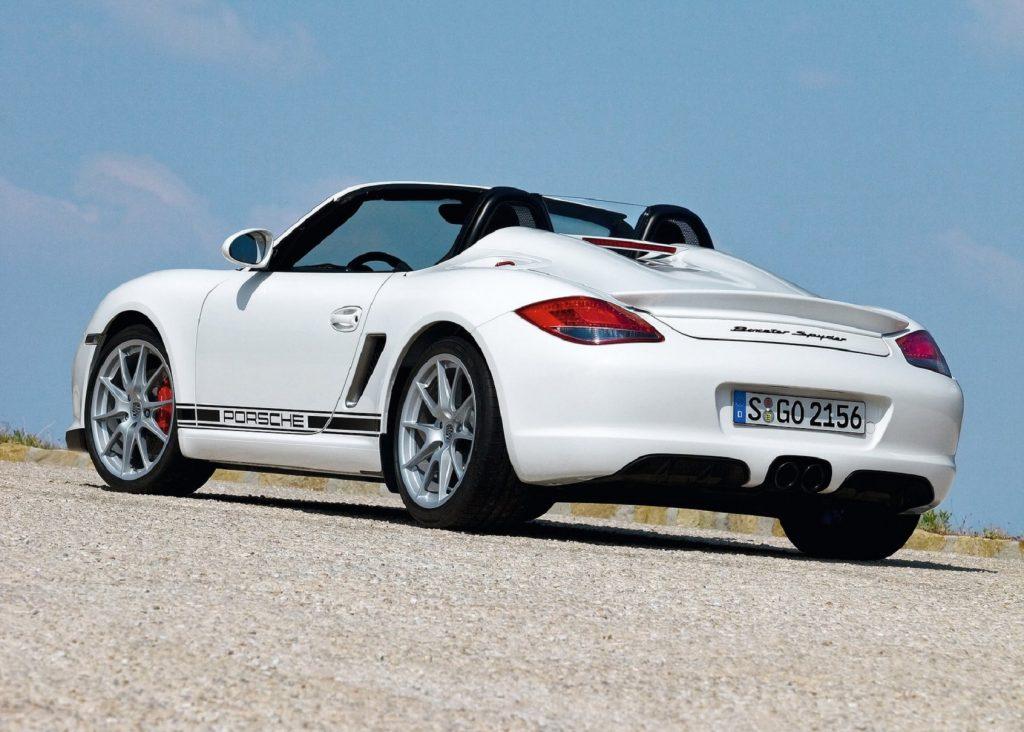The rear 3/4 view of a white 2010 Porsche Boxster Spyder