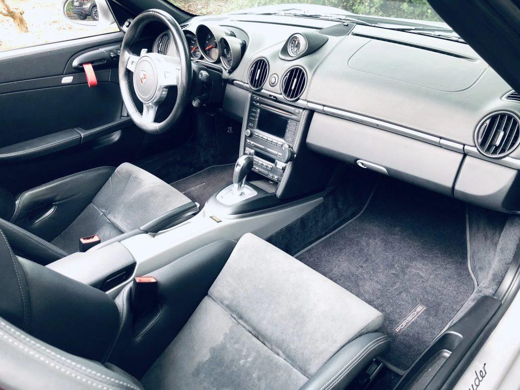 The black interior of a 2011 Porsche Boxster Spyder