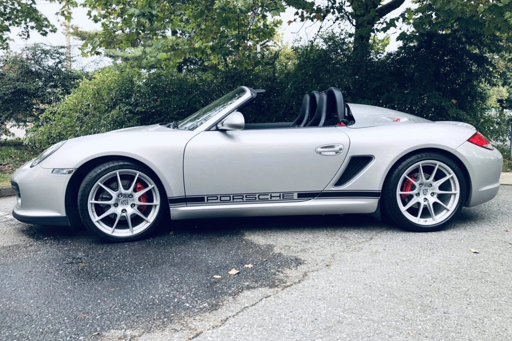 The side view of a silver 2011 Porsche Boxster Spyder