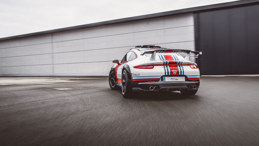 The rear view of the white-red-and-blue 2012 Porsche 911 Vision Safari