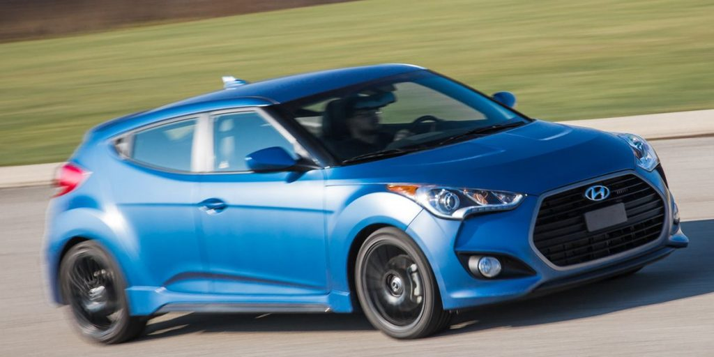 A blue, turbocharged 2016 Veloster on the track.