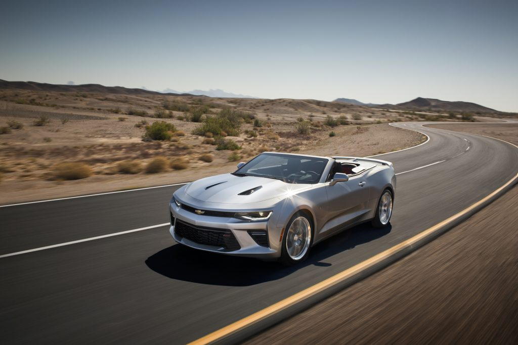 An image of a Chevy Camaro Convertible rolling down the road.