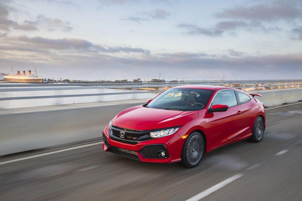 red 2017 Honda Civic sedan driving on highway bridge