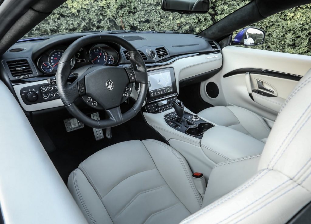 The white-leather-upholstered 2018 Maserati GranTurismo's interior