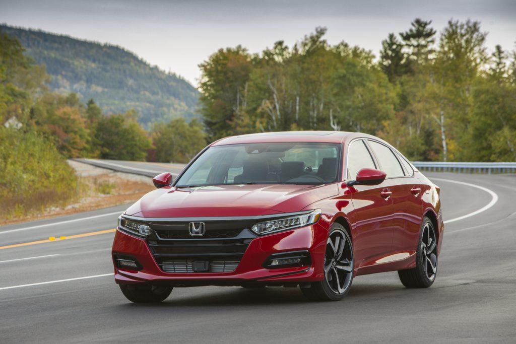 2018 Honda Accord Sport driving on empty road around bend