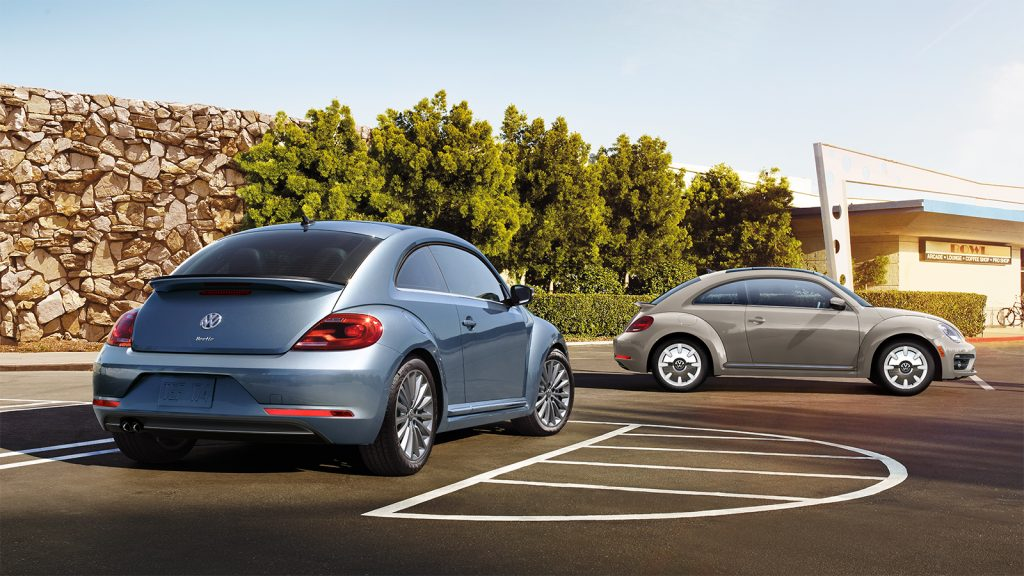 A pair of 2019 Volkswagen Beetle Final Editions on display in a parking lot