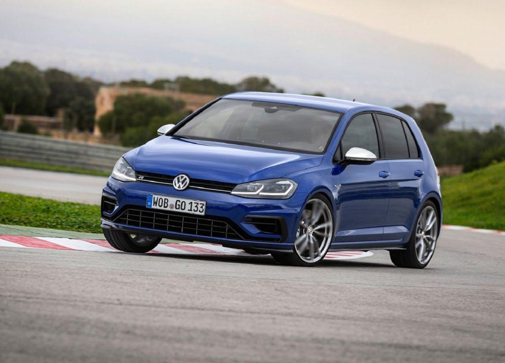 A blue 2019 Volkswagen Golf R drives on a racetrack