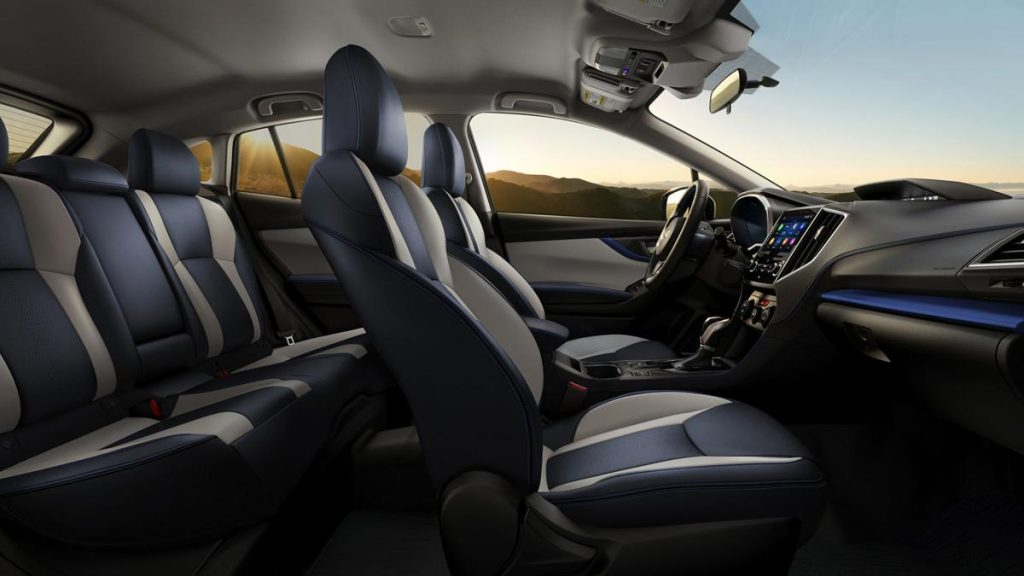 A sideview of a 2019 Crosstrek with black leather seats.