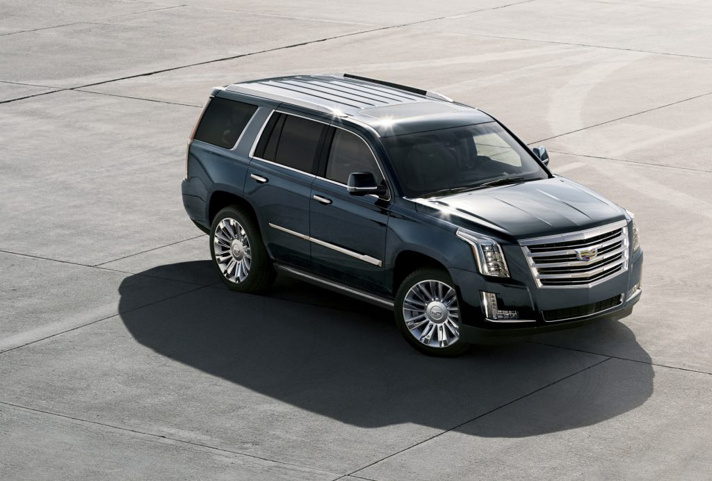 A dark blue 2020 Cadillac Escalade parked on display
