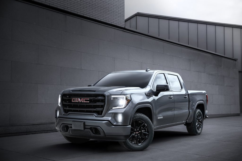 A gray 2020 GMC Sierra 1500 parked in front of a gray wall