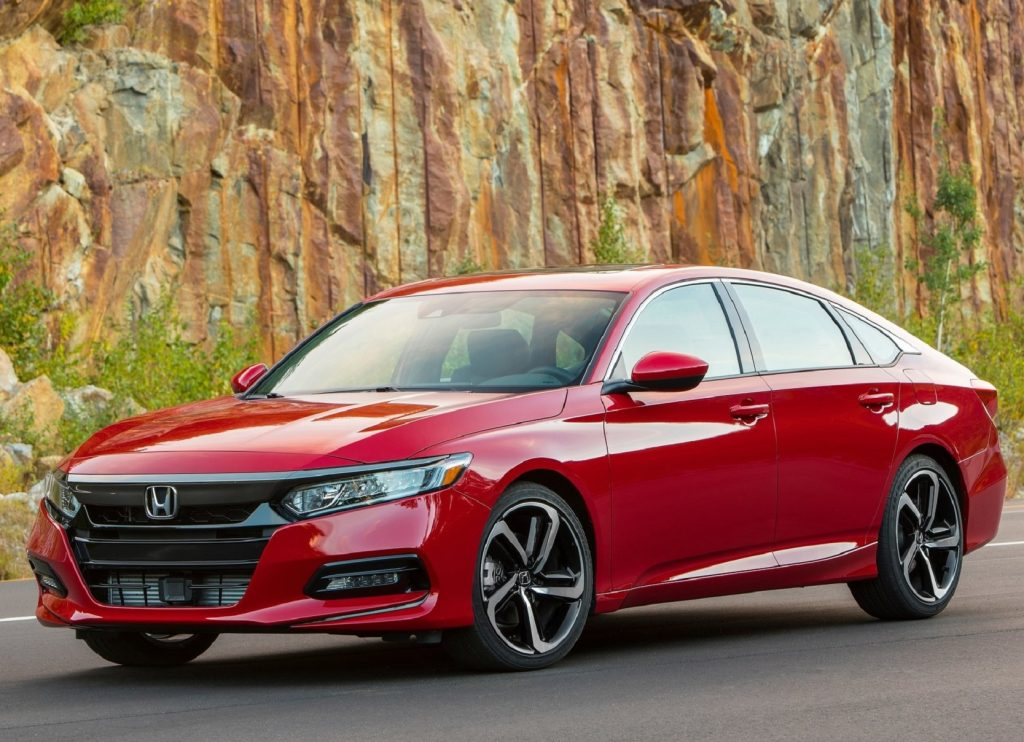 A red 2020 Honda Accord 2.0T Sport by a rocky hill