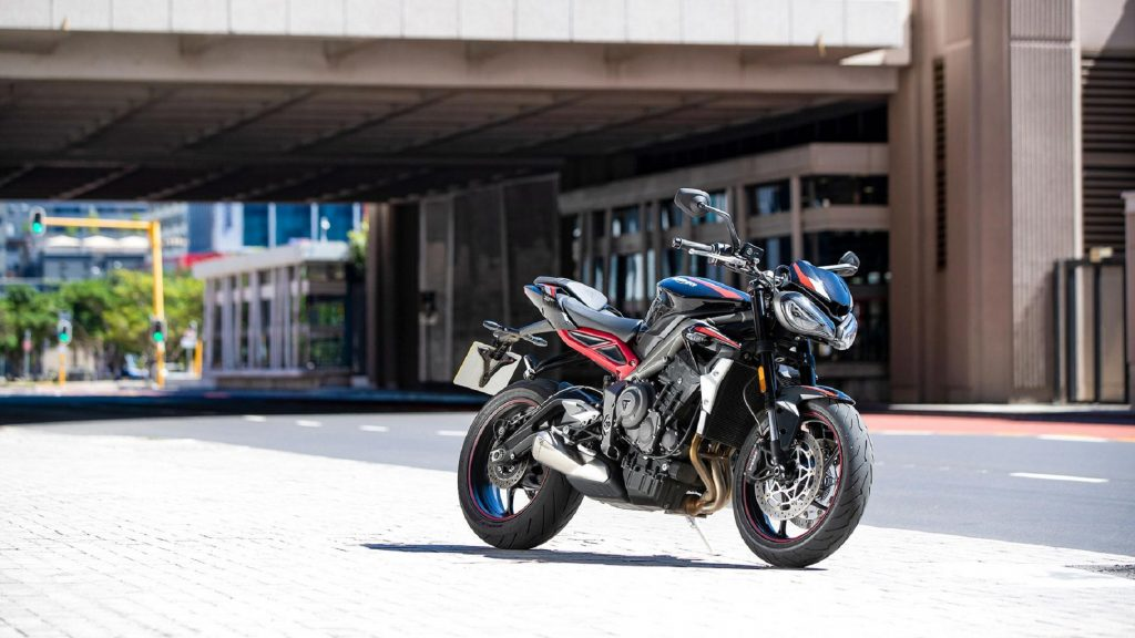 A black-and-red 2020 Triumph Street Triple R on a city street
