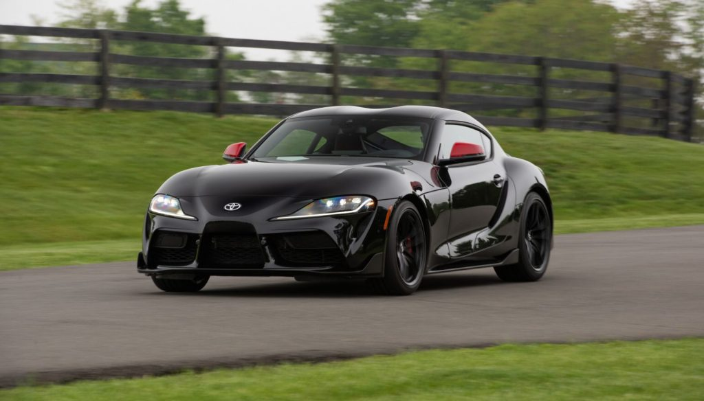 An image of a Toyota Supra driving down the street.