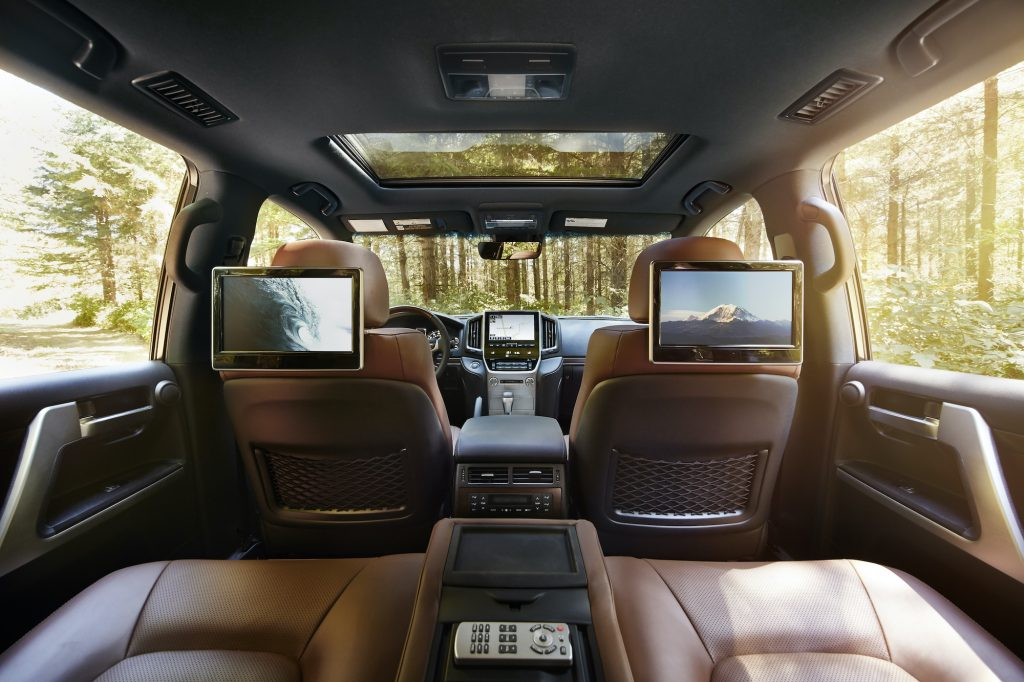 the interior of the Toyota Land Cruiser with a view of the rear entertainment system shows the balance between rugged capability and ample luxury