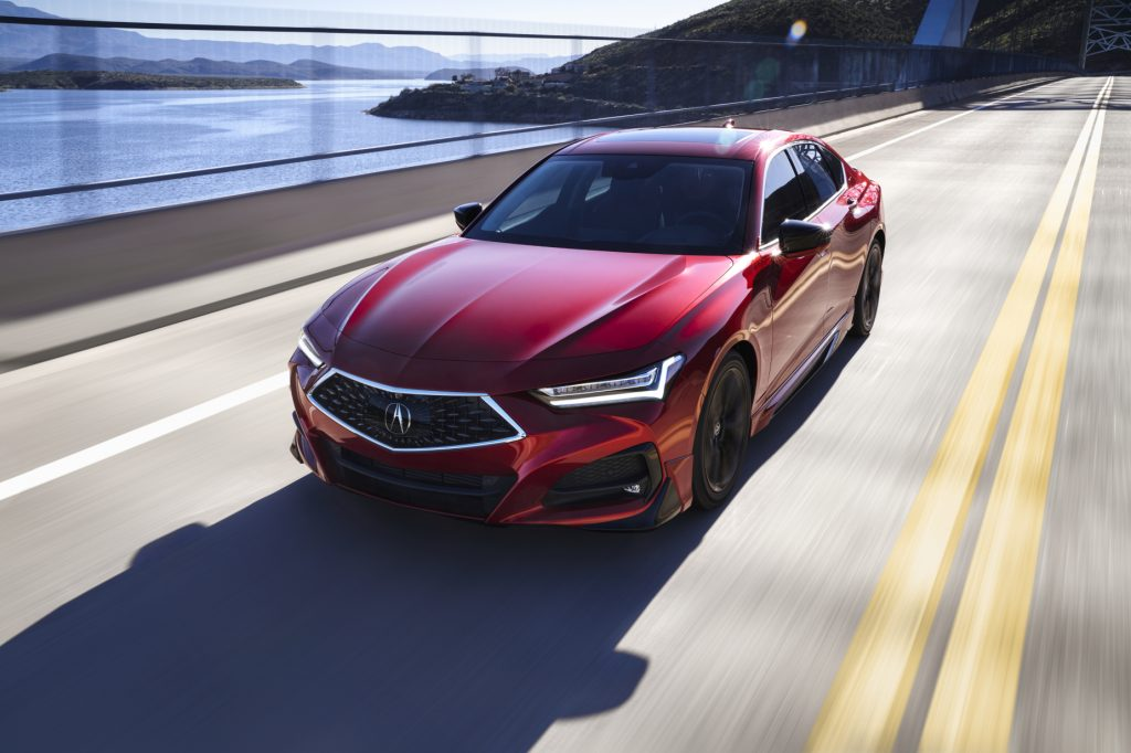 A red 2021 Acura TLX driving down a highway