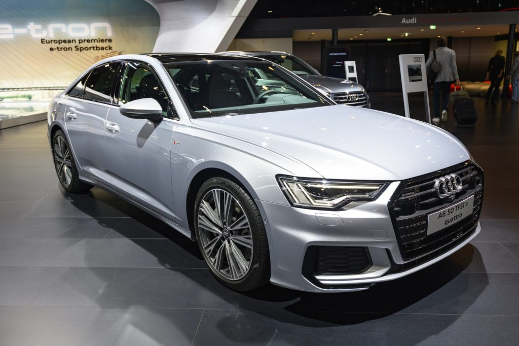 A white 2021 Audi A6 on display at an auto show