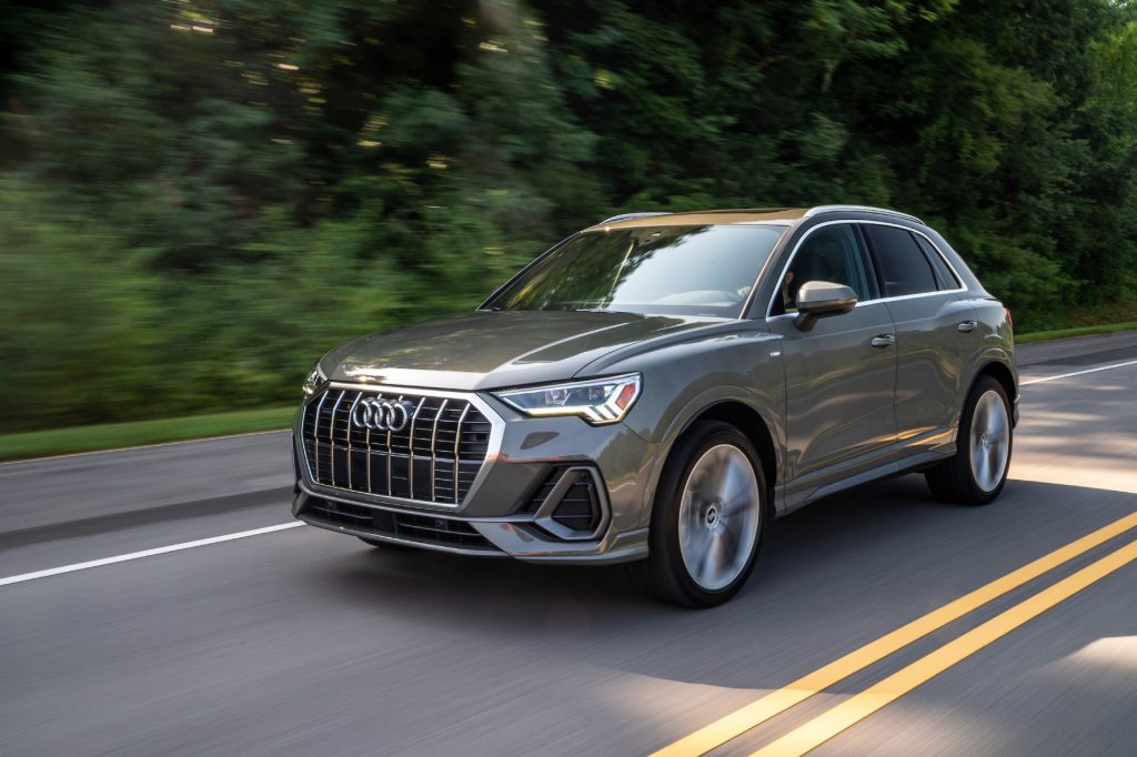 A silver 2021 Audi Q3 driving down a highway street