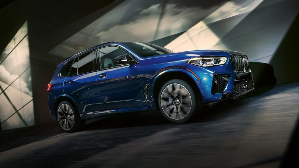 The side view of a blue 2021 BMW X5 M