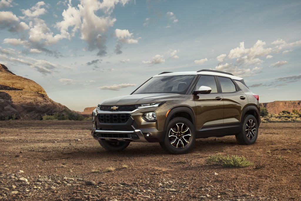 A brown and white 2021 Chevy Trailblazer on display in a rugged enviroment