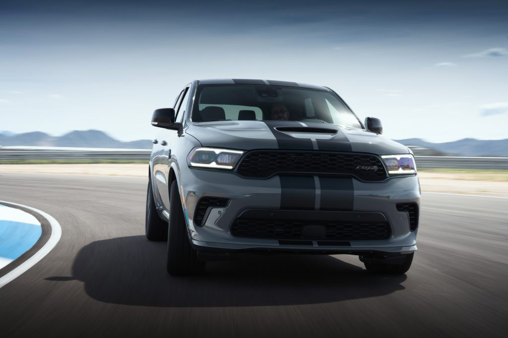 A silver and black 2021 Dodge Durango Hellcat driving on a track