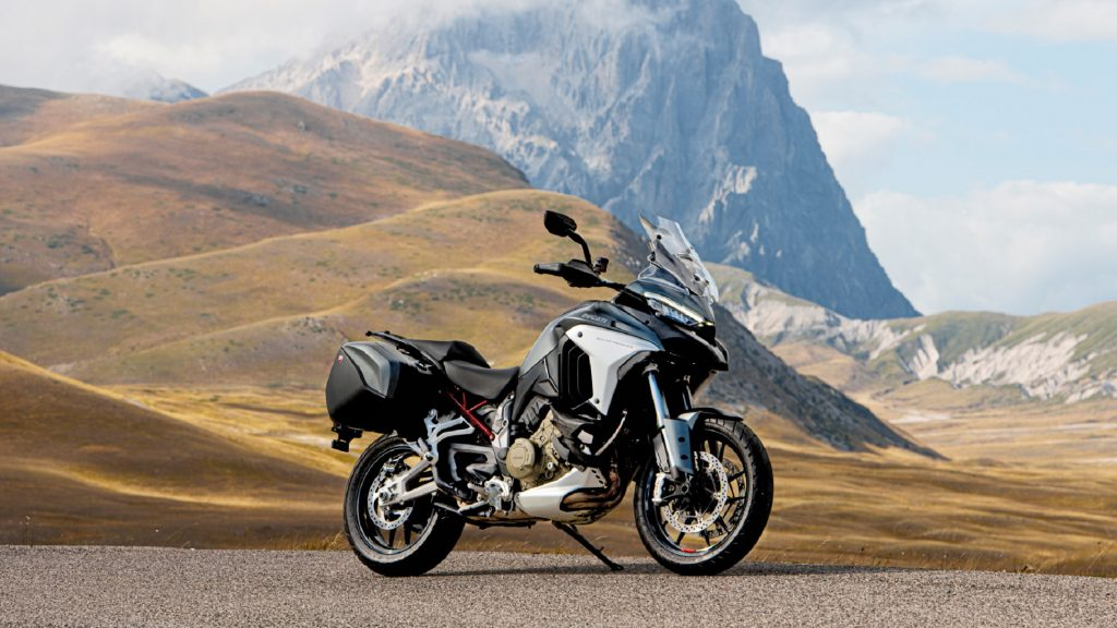 A gray-and-black 2021 Ducati Multistrada V4 S in front of a mountain
