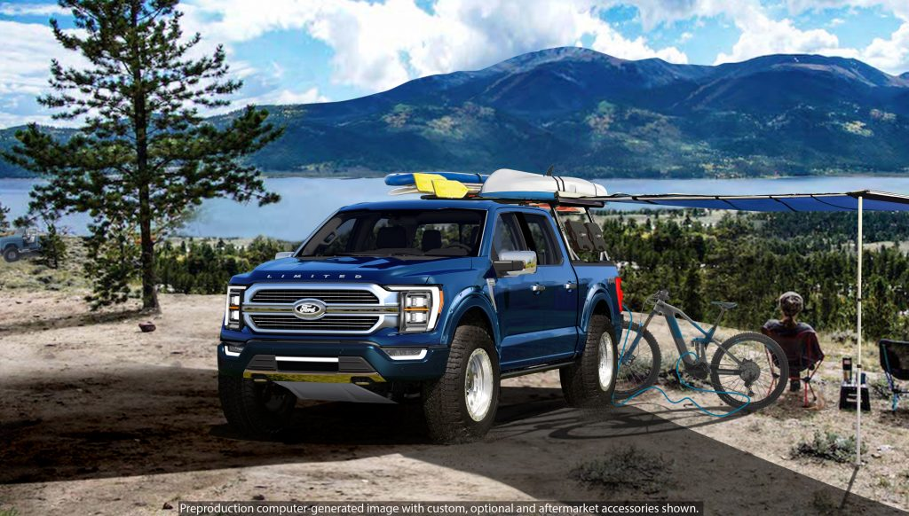 The blue 2021 Ford F-150 Limited Hybrid SuperCrew by BDS Suspension next to a mountain lake