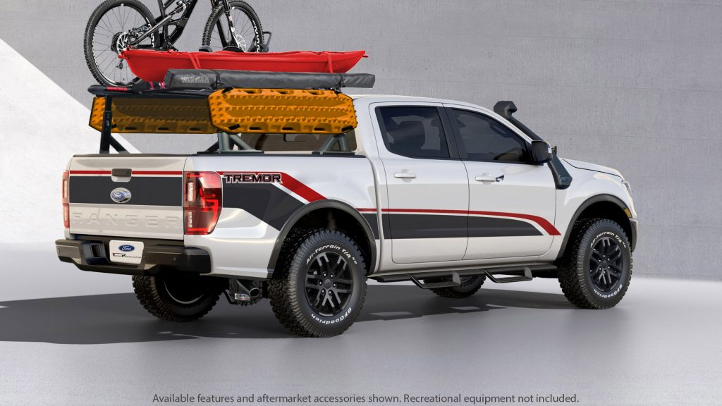 The rear 3/4 view of a white-black-and-red 2021 Ford Ranger XLT Tremor SuperCrew modified for SEMA