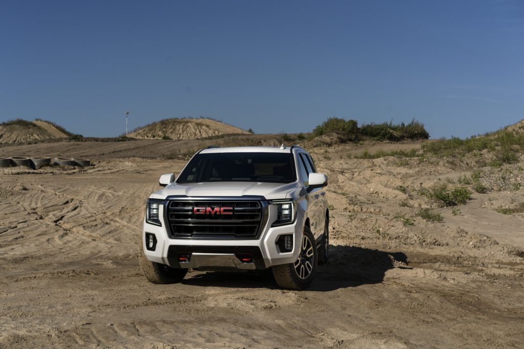A 2021 GMC Yukon AT4 driving on sandy terrain