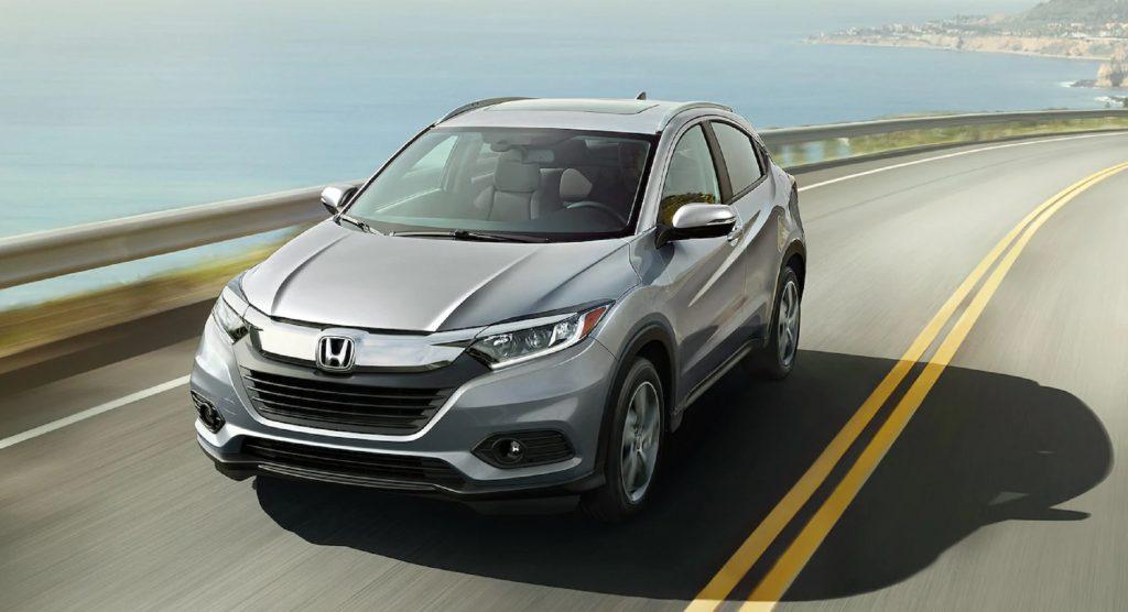 A silver 2021 Honda HR-V EX-L drives on an ocean-side road