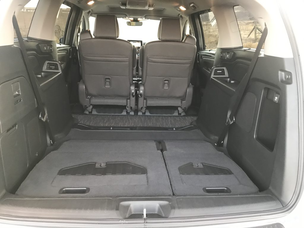 A 2021 Honda Odyssey with all the rear seats folded doen.