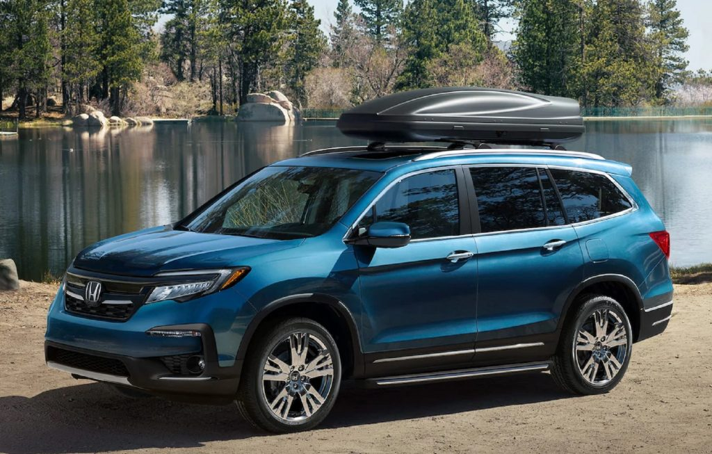 A blue 2021 Honda Pilot Elite with a roof box