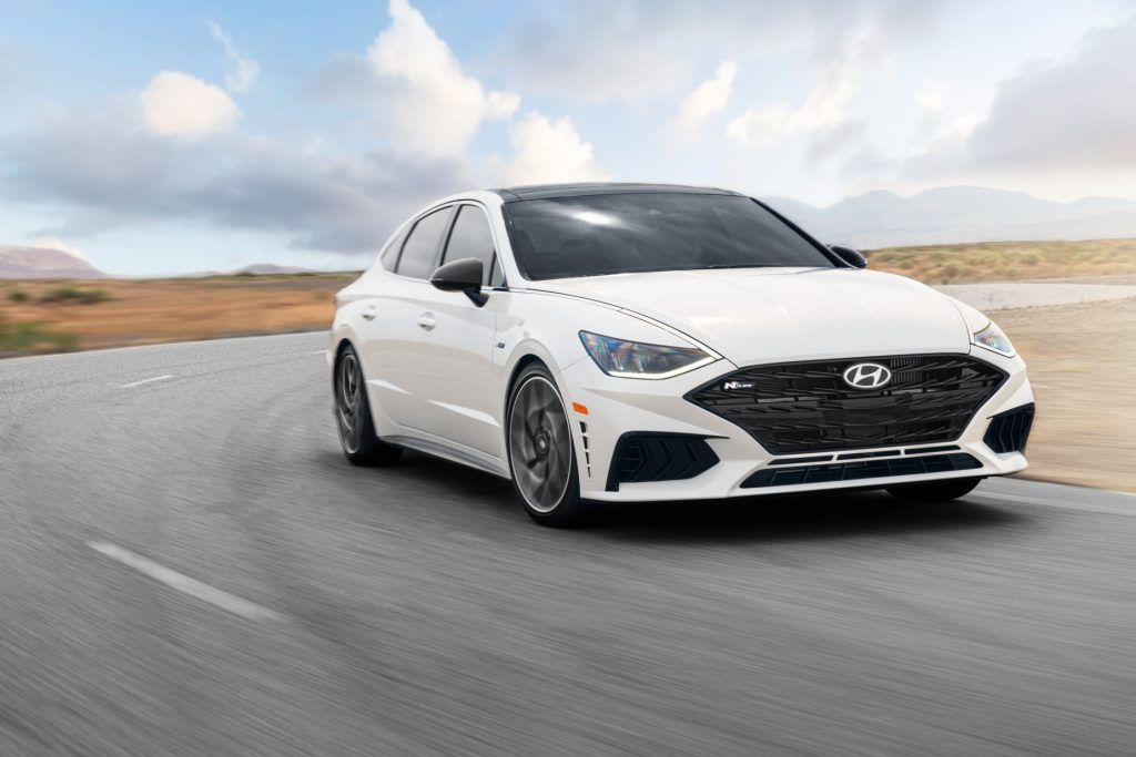 A white 2021 Hyundai Sonata N Line driving on a road