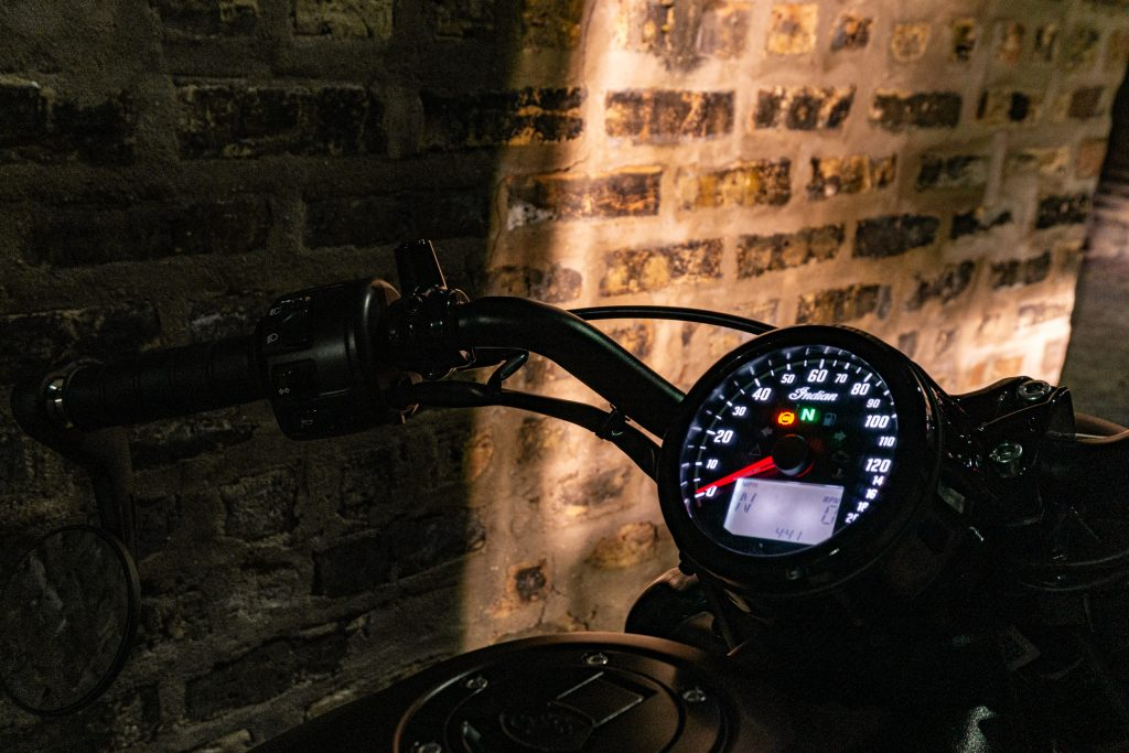 A close-up of the 2021 Indian Scout Bobber's gauge at night