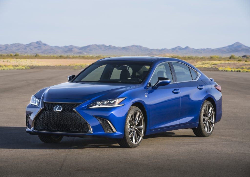 A blue 2021 Lexus ES on display with a mountain range in the background