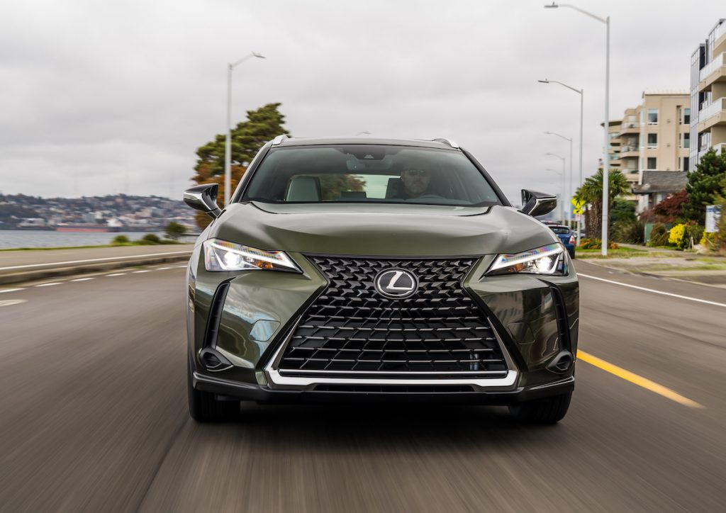 front of a green 2021 Lexus UX