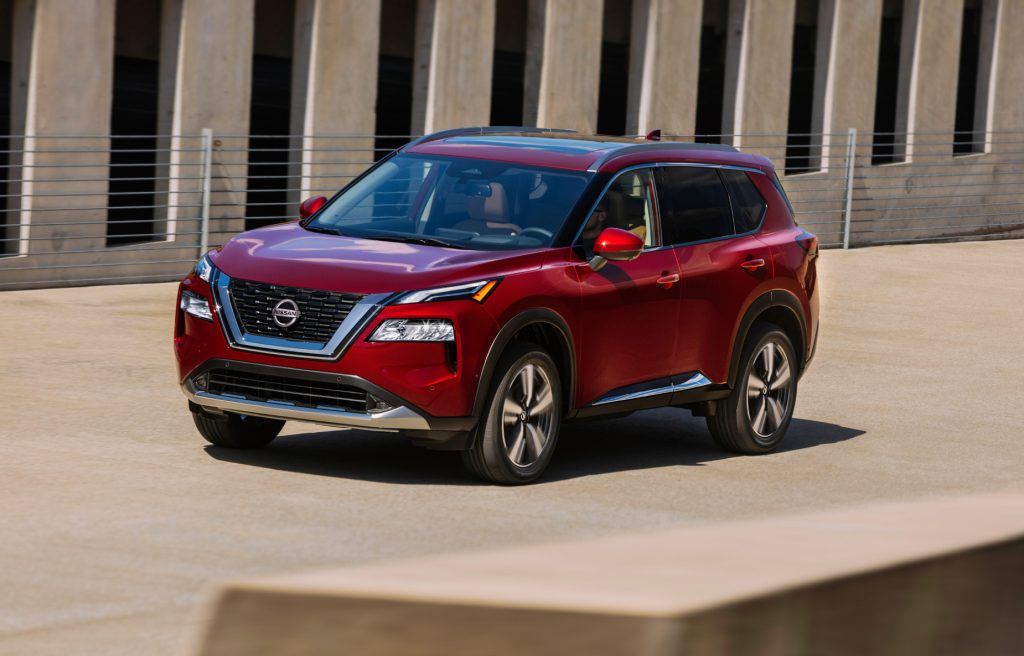 A red 2021 Nissan Rogue compact SUV on display