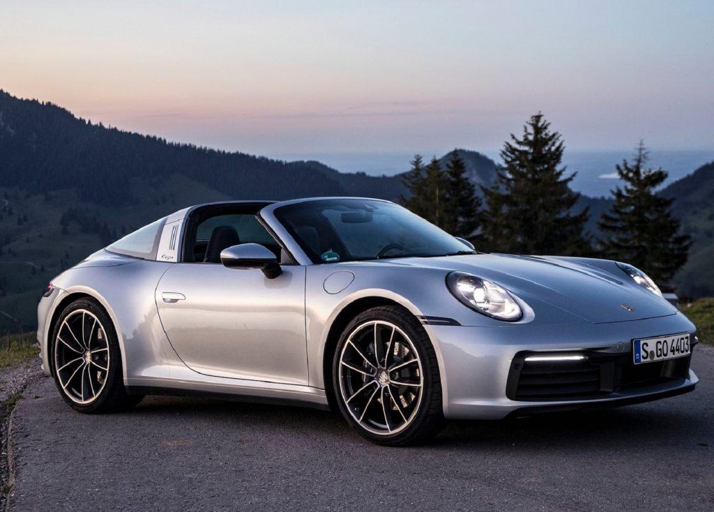 A silver 2021 Porsche 911 Targa 4 on a sunset mountaintop