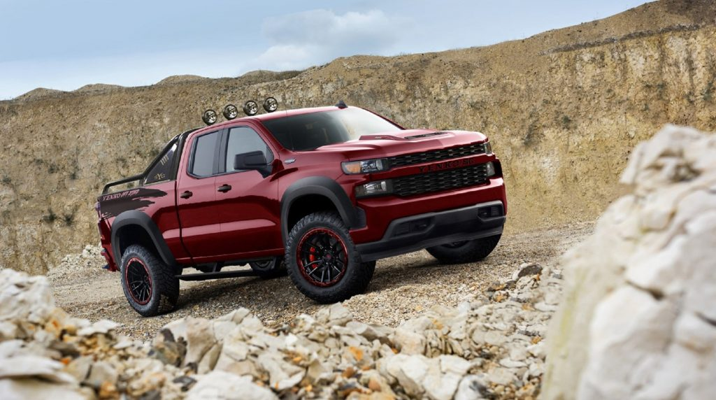 A red 2021 SVE Yenko Chevrolet Silverado Off-Road climbs a rocky desert mountainside