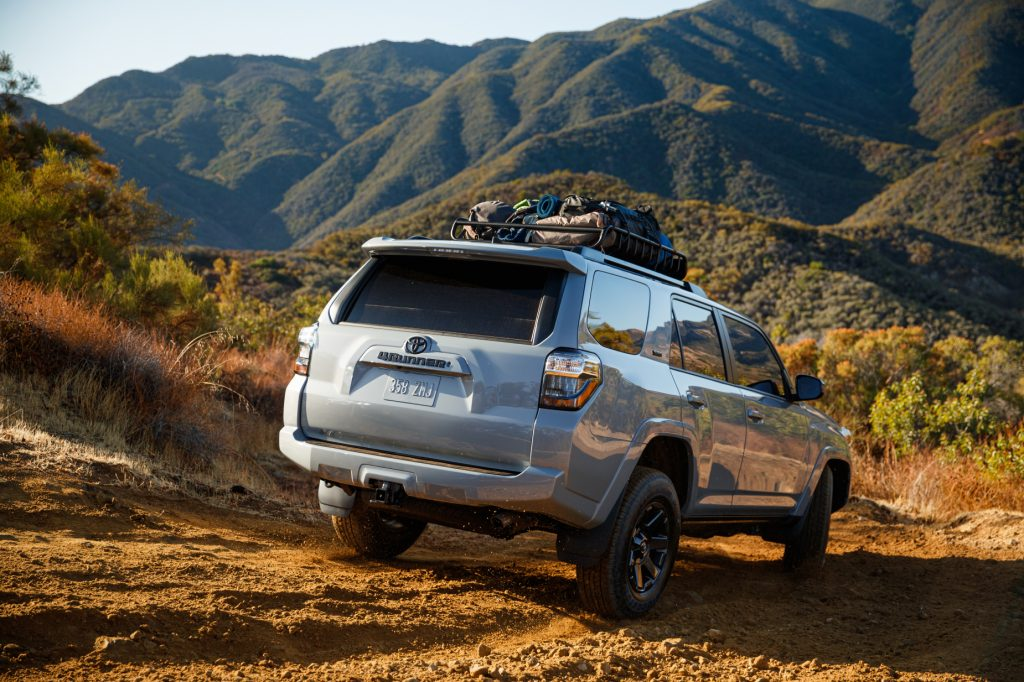 A silver 2021 Toyota 4Runner driving on rugged terrain