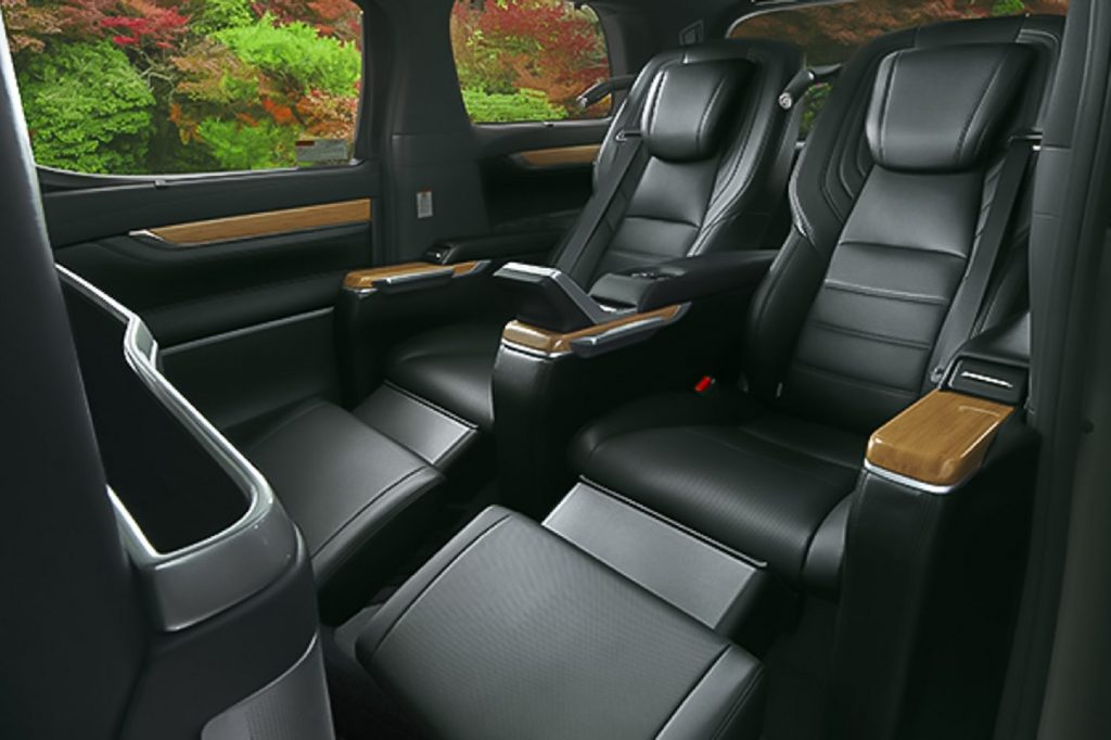 The rear black Nappa leather seats of the 2021 Toyota Alphard Royal Lounge