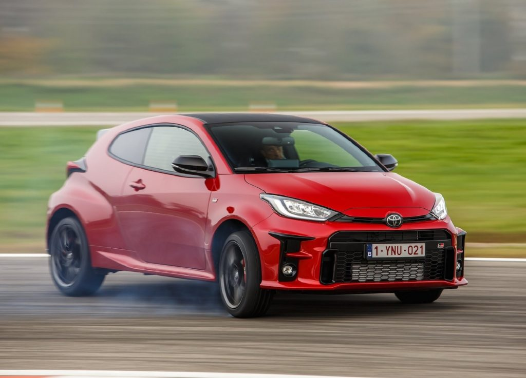 A red 2021 Toyota GR Yaris slides on a track