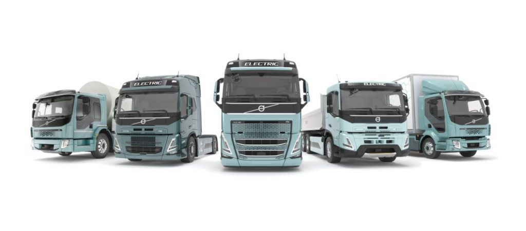 Five heavy-duty trucks are lined up to represent Volvo's all-electric offerings.
