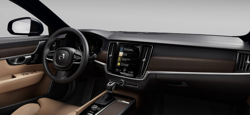 The tan-leather front seats and walnut dashboard of the 2021 Volvo V90 T6 Inscription