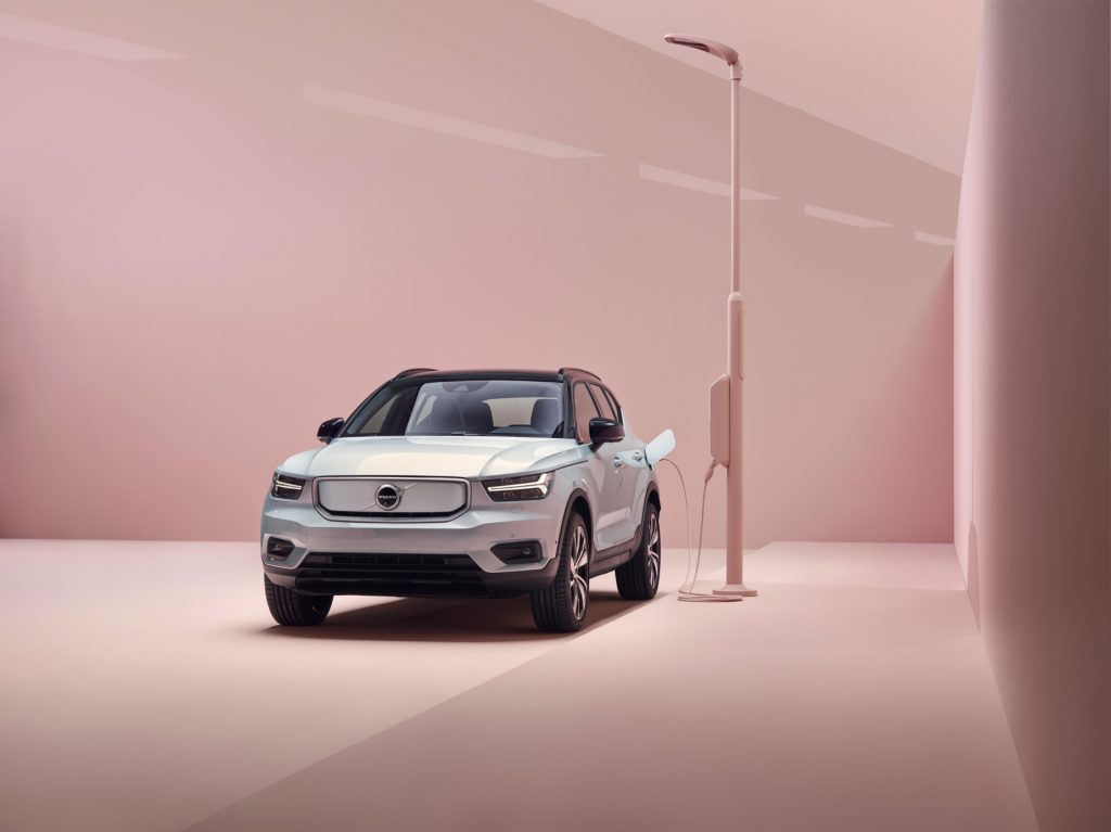 A silver 2021 Volvo XC40 Recharge connected to a charging port