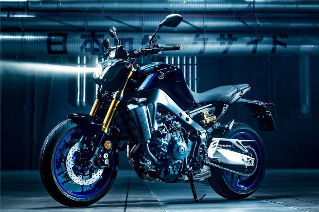 A black-and-blue 2021 Yamaha MT-09 SP in a warehouse