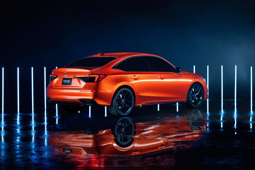A orange 2022 Honda Civic prototype on display during the car's reveal