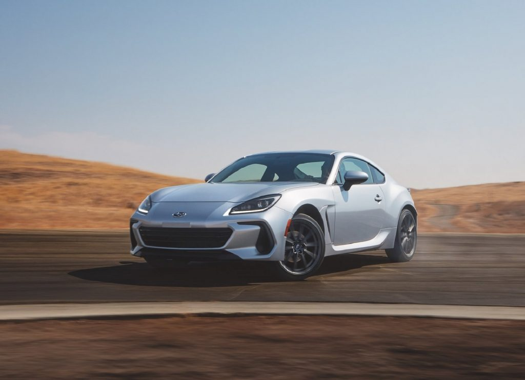 A silver 2022 Subaru BRZ drifts on a racetrack