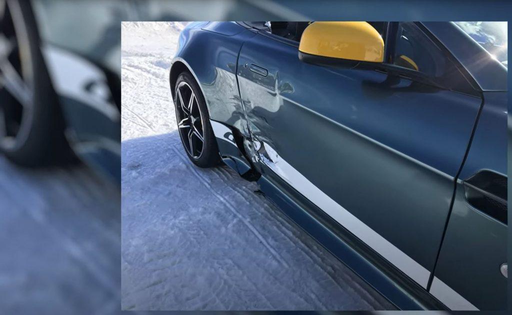 Damage to an Aston Martin's rear 3/4 panel.
