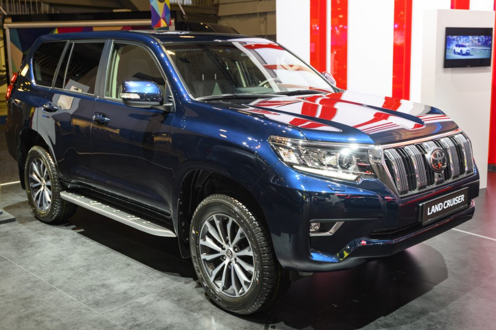 A Toyota Land Cruiser on display at an auto show