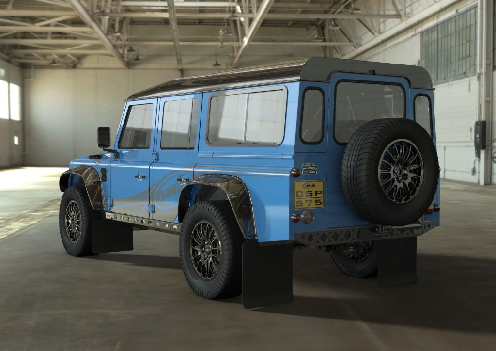 The rear 3/4 view of a blue Bowler CSP 575 Land Rover Defender